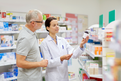 pharmacist assisting senior man of his drug prescription